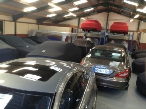 Luxury cars in storage at Classic Car Storage UK facilities.