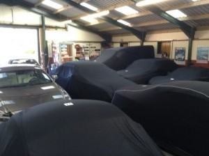 Cars under car covers at Classic Car Storage UK storage facilities.