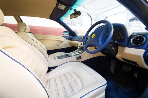 Luxury white leather interior of a classic Ferrari.