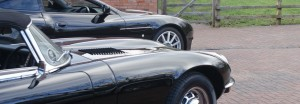 A classic Jaguar and Aston Martin at Classic Car Storage UK.