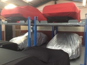 Cars in multi-level storage systems at Classic Car Storage UK.