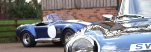 A AC Cobra and a classic Jaguar at Classic Car Storage UK.